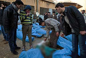 At least 65 bodies found in Syrian mass killing, activists say