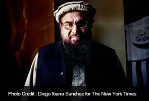 Pakistani militant strikes a less militant tone