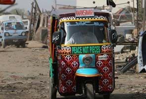Eye-catching rickshaws promote peace in Pakistan