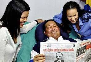 Sick Hugo Chavez back, but mystery lingers