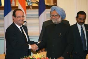 French President Francois Hollande holds talks with Prime Minister Manmohan Singh, sees progress on $12bn fighter jet deal