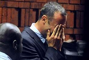 Sobbing Oscar Pistorius accused of 'premeditated' girlfriend murder