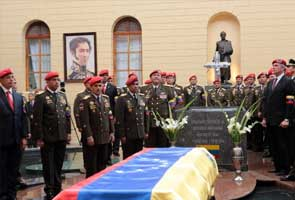 Hugo Chavez buried after final tour of Caracas