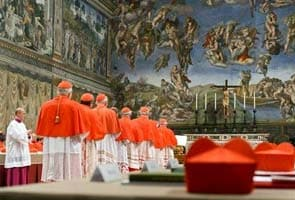 For cardinals at conclave, cigarette and a tipple to relieve papal tension