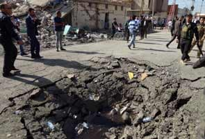 Iraq attacks kill 12, wound 165