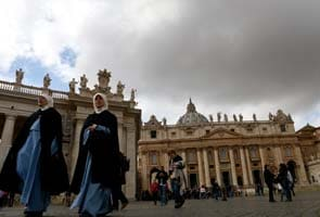 Living ex-pope an invisible presence at conclave
