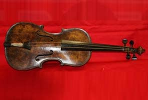 Violin played on sinking Titanic found in British attic