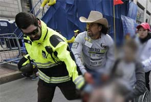 In signal image from Boston bombing, a father sees his son