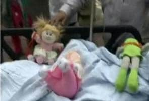 Blog: On Delhi 5-year-old's hospital bed, three dolls