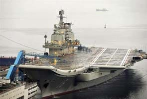 China to build second, larger carrier for fighter jets: report