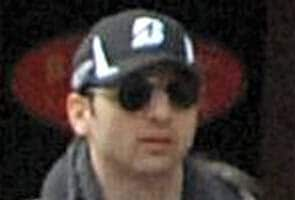 Boston Marathon bombing suspect died of gunshots, trauma: reports