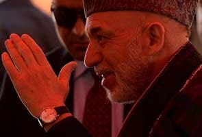 Afghanistan President Hamid Karzai in India; to meet Prime Minister Manmohan Singh today