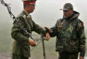 China plays down border frictions with India