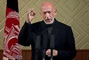 Afghanistan President Hamid Karzai seeks Indian military aid amid Pakistan row