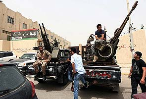 Libya gunmen surround justice ministry in Tripoli