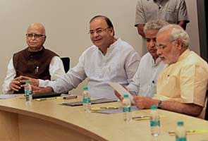 Narendra Modi attends his first BJP parliamentary board meeting in Delhi