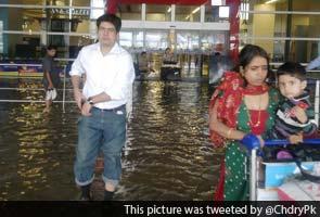 Delhi airport flooded, passengers wade through knee deep water