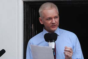 Julian Assange urges Edward Snowden to seek asylum in South America or Russia