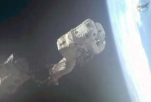 NASA aborts spacewalk after water leak in astronaut's helmet