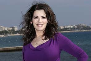 Art collector Saatchi divorcing TV chef wife Nigella Lawson after row