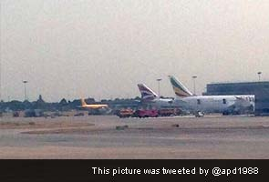 Fire on parked plane shuts down runways at Heathrow for an hour