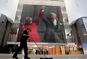 Millions stand at vigil to honour Nelson Mandela's legacy