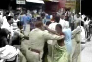 Caught on camera: Madhya Pradesh police official thrashes woman protester