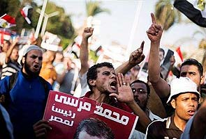 Germany calls for release of Mohamed Morsi, protesters gather at Cairo