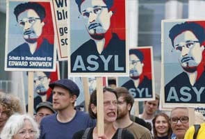 Amnesty official in Russia plans to meet Edward Snowden