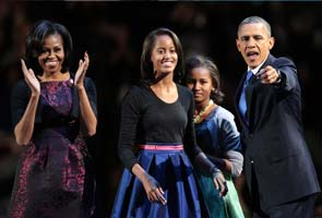 Barack Obama reminds daughters their life 'not the norm'