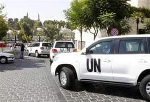 Syria: UN inspectors come under fire, Washington warns Assad