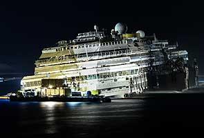 Shipwrecked Costa Concordia declared vertical off Italy