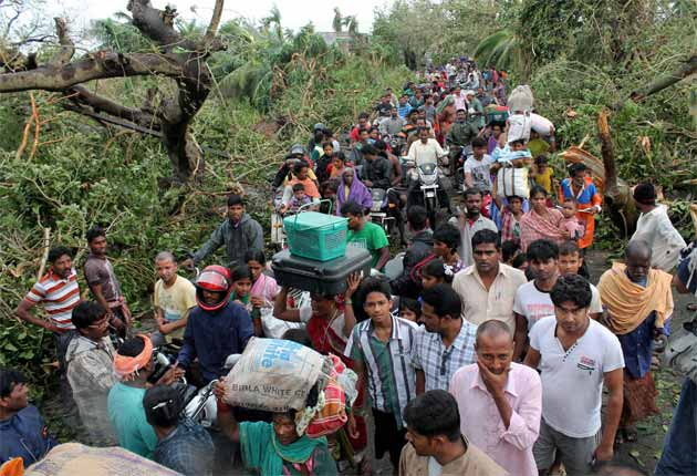 Cyclone Phailin kills 23, mass evacuations save thousands
