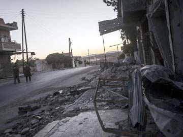 Syria rebel chieftain killed; Bashar Assad forces bomb besieged town
