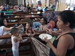 Philippine typhoon toll rises to record 5,209: official