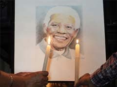 Friend and foe, world leaders coming together for Nelson Mandela