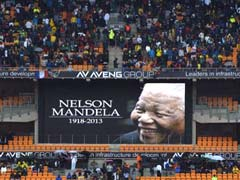 Leaders gather, thousands sing in rain in farewell to Nelson Mandela