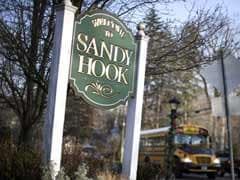 Newtown's year: Struggle to move on from shooting