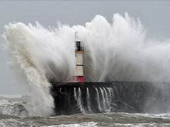Storms in UK cause power cuts, batter sea walls