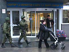 Armed men seize two airports in Ukraine's Crimea, Russia denies involvement