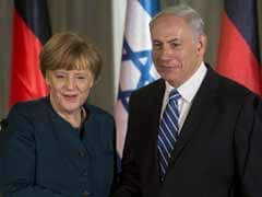 Angela Merkel in Israel to discuss Iran, peace talks