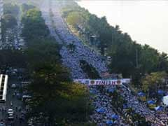 Tens of thousands in Philippine sect's walk for typhoon aid