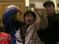 Relatives sob after announcement on missing Malaysia Airlines plane