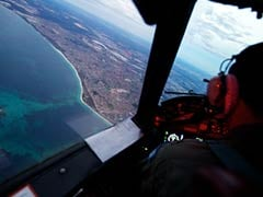Planes, ships chase new leads in search for Malaysian jet