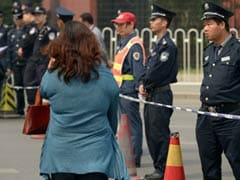 China shuts embassy area after protests by MH370 relatives