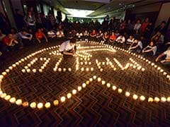MH370 family members hold candlelight vigil in Beijing