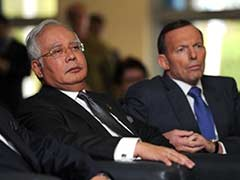 Malaysian PM in Perth as Australia says search will go on for missing jet