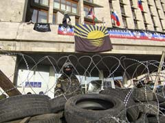 Kiev fears invasion as pro-Moscow protesters declare eastern Ukrainian city a republic
