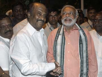 Wish Modi well, says Rajinikanth with a hug