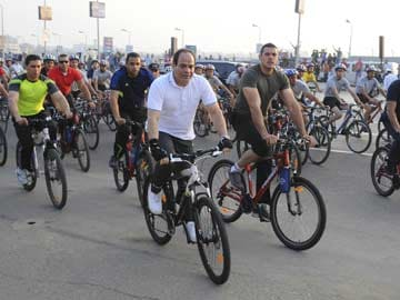Dressed for Cycling, Egypt's President Fattah al-Sisi Calls for Help on Fuel Subsidies